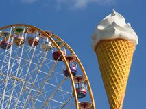 Ferris wheel and ice cream cone. Giant ice cream cone in front of a ferris wheel at the Vincennes fair (Foire du Trone) - Paris, France royalty free stock image