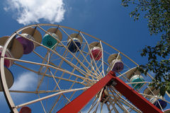 Ferris Wheel II. This Ferris wheel from the 1970s still has the original colors in its cars. The structure of the wheel combines lightness with strength Stock Images