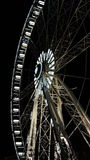 Ferris wheel. Bottom view of lighted ferris wheel in Budapest at night Royalty Free Stock Image