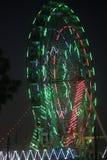 Ferris wheel illuminated in the dark sky Royalty Free Stock Images