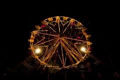 Ferris Wheel illuminated at night in amusement park. Stock Images