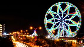 The ferris wheel known as the MOA Eye, is illuminated at night taken using a slow shutter speed in camera. The MOA Eye Ferris stock photos