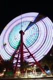 Ferris Wheel in Kobe Japan spinning. Ferris Wheel spinning in Kobe Port in Japan.  Time lapse Stock Images