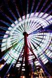 Ferris Wheel in Kobe Japan spinning 2. Ferris Wheel spinning in Kobe Port in Japan. Time lapse and zom Stock Photos