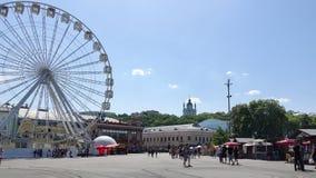 The Ferris wheel at Kontraktova Square in Kiev in the summer. Kiev, Ukraine - may 09, 2018 The Ferris wheel at Kontraktova Square in Kiev in the summer weekend stock photo