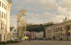 The Ferris wheel at the Kontraktova Square on Podil in the historical center of Kyiv, Ukraine. Kyiv, Ukraine - September 29, 2018: The Ferris wheel at the royalty free stock images