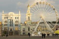 The Ferris wheel at the Kontraktova Square on Podil in the historical center of Kyiv, Ukraine. Kyiv, Ukraine - September 29, 2018: The Ferris wheel at the stock photography