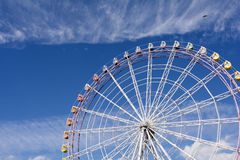 Ferris wheel. Large ferris wheel facing diagonally under blue sky Stock Photo
