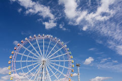 Ferris wheel. Large ferris wheel facing front under blue sky with clouds Stock Photo