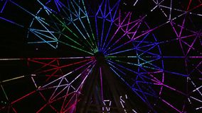 A Ferris wheel light show at evening video stock footage
