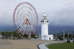 Ferris wheel and lighthouse on the seafront in Batumi Stock Image