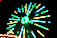 Ferris wheel Lights. Blurred varicolored royalty free stock photo