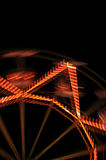 Ferris wheel lights. At night abstract motion blur Royalty Free Stock Photos