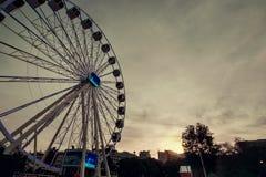 Ferris wheel in Lisbon at dusk royalty free stock image