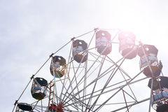 Ferris wheel at local fair in India with sun flare Royalty Free Stock Photos
