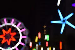 Ferris wheel and many light in the night festival royalty free stock photo