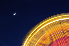 Ferris Wheel with Moon. Ferris Wheel with night sky and crescent moon taken with slow shutter to create beautiful graphic design Stock Photos