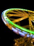 Ferris Wheel in motion. At night. Amusement park series Stock Photo