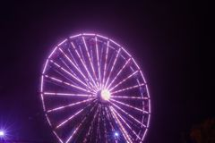 Ferris wheel in motion at the amusement park, night illumination. Long exposure.  royalty free stock photos