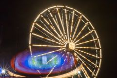 Ferris wheel in motion at the amusement park, night illumination. Long exposure.  stock photography