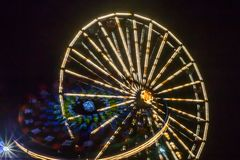 Ferris wheel in motion at the amusement park, night illumination. Long exposure.  stock images