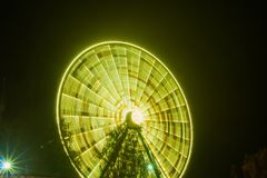 Ferris wheel in motion at the amusement park, night illumination. Long exposure.  royalty free stock images