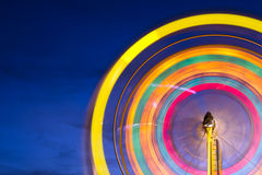 Ferris wheel with motion blurred lights Royalty Free Stock Image