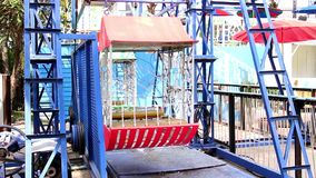 Ferris wheel with multicolored in amusement park. Retro style vintage. Underside view of a ferris wheel. stock footage