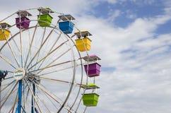 Ferris wheel with multicoloured seats. Stock Photos