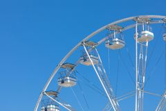 Ferris wheel municipal park with blue clear sky on the backgroun. D Royalty Free Stock Images