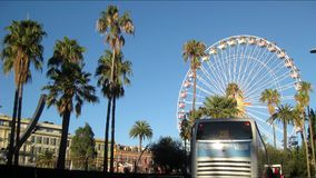 Ferris wheel in Nice, France. Timelapse of Ferris wheel and palm trees in Albert I Garden, Nice, France, on a sunny day. 07 December 2016 stock video