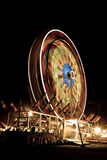 Ferris Wheel at night. Lit up ferris wheel in motion at night stock image