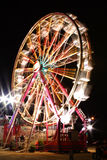 Ferris Wheel At Night. Ferris wheel in motion one evening at the carnival Stock Image