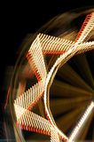 Ferris wheel at night. Abstract blurry shapes amusement park lights in motion Stock Photography