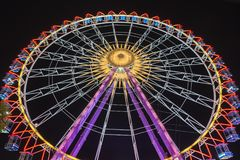 Ferris Wheel at night with beautiful lights. In Stuttgart at the Volksfest Cannstatter Wasen. Also you can see it in Munich at teh Oktoberfest Stock Photo