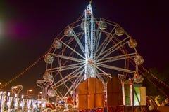 Ferris wheel at night, Howrah, West Bengal, India. Royalty Free Stock Image