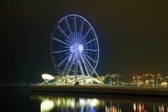 Ferris wheel in the night landscape. Evening Baku, Azerbaijan stock image
