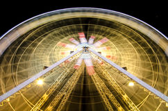 Ferris wheel at night in Nice, France. Ferris Wheel at night during carnival in amusement park. Long exposure shot Stock Image
