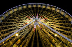 Ferris wheel at night in Nice, France. Ferris Wheel at night during carnival in amusement park. Long exposure shot Stock Images