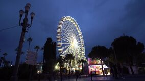 Ferris Wheel in the night panoramic wheel giant wheel in the Nice stock video footage