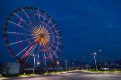Ferris wheel and night park Stock Photos