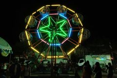 Ferris wheel night scenes. Colorful fluorescent light. Royalty Free Stock Images