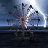 Ferris wheel night stormy view. Dramatic view of Ferris wheel against night stormy background Royalty Free Stock Photography