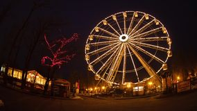 Ferris wheel at night time, time lapse stock footage