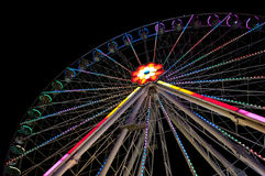 Ferris wheel by nightime. Colorful Ferris wheel during nighttime Royalty Free Stock Images