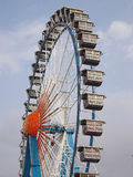 Ferris wheel at Oktoberfest. The picture shows a ferris wheel at the traditional Munich Octoberfest. Only the upper part of the big wheel is seen. The image was royalty free stock images