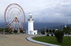 Ferris wheel and old lighthouse in Batumi Stock Images