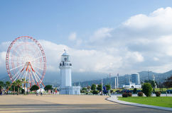 Ferris wheel and old lighthouse in Miracle Park,Batumi,Georgia Stock Photo
