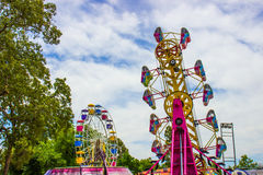 Ferris Wheel & Other Ride At Small County Fair. Ferris Wheel & Tilting Ride At Small County Fair Royalty Free Stock Photos