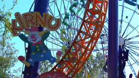 Ferris wheel and other rides in the amusement Park. HELSINKI, FINLAND - JUNE 07, 2016: Ferris wheel and other rides in the amusement Park Linnanmaki in Helsinki stock video footage